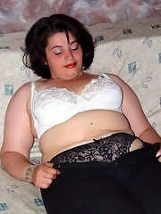 Plump Mature Stripping And Getting Naked
